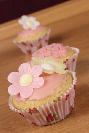 Sweet cupcakes with flowers photo