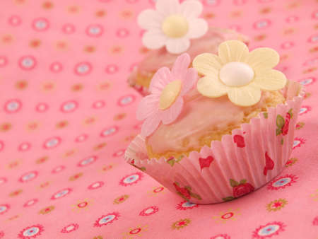 Pink cupcakes with sweet flowers         photo