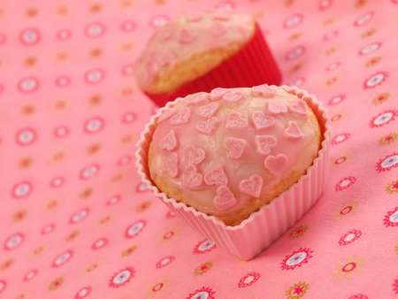 Sweet cupcakes with pink hearts photo