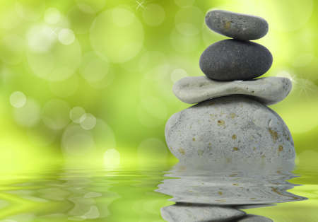 Wellness background with stacked stones on green photo