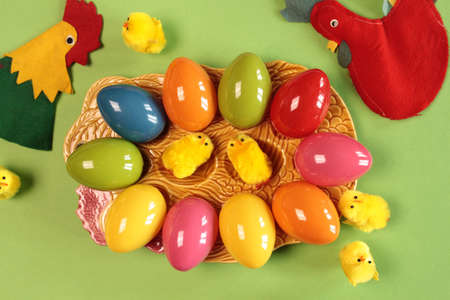 Colorful Easter eggs on a plate photo