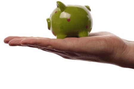 Green piggy bank, saving money concept photo