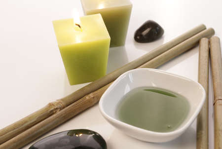Bath additive with candles and bamboo Stock Photo - 11863536