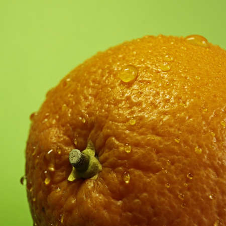 Fresh orange with drops of water Stock Photo - 13207226