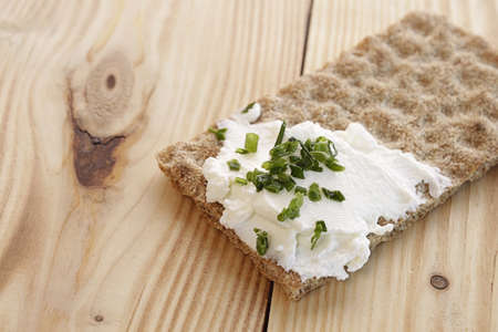 royalty free photo: Whole grain bread with curd and chives