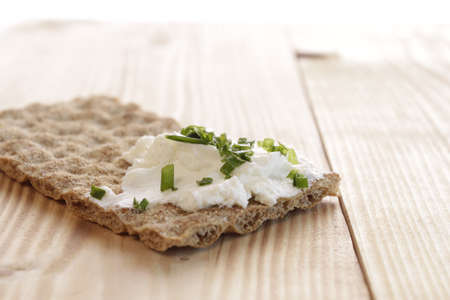 Whole grain bread with curd and chives