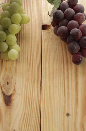 Grapes with a wooden background photo