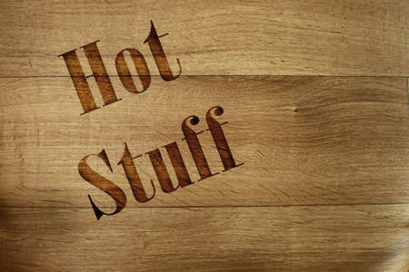 Hot stuff, wooden background grunge style photo