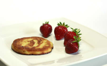 Sweet pancake with fresh strawberries photo