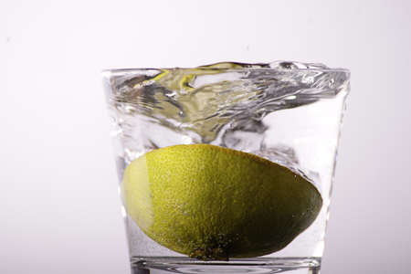 Fresh lemon in a glass of water photo