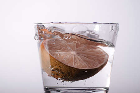 Fresh orange in a glass of water photo