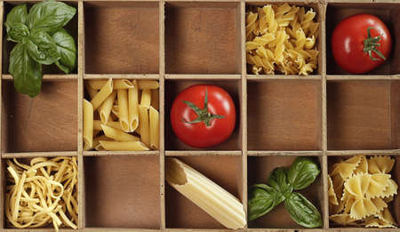 Pasta mis with fresh tomatoes and basil Stock Photo