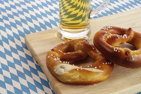 Bavarian flag with two pretzels and a glass of beer photo