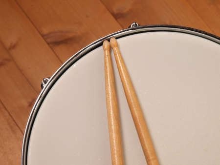 Detail of a snare drum with drum sticks photo