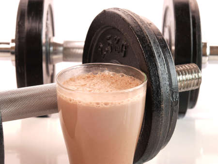 chocolate shake: Fitness drink with heavy weights            Stock Photo