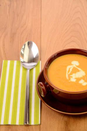 Creamy soup of carrots photo