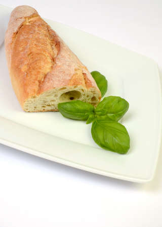 Ciabatta with a leaf of basil Stock Photo - 19134336