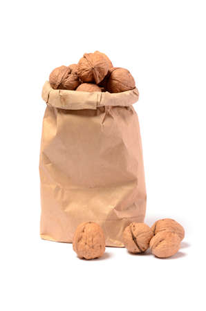Walnuts in a paper bag on a white background photo