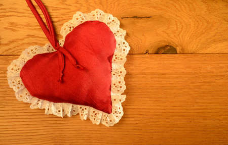 Red heart shape on a wooden background Stock Photo - 21024544