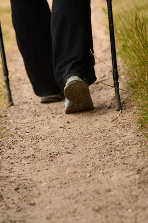 Background with a woman is nordic walking, Focus on foreground with space for text photo