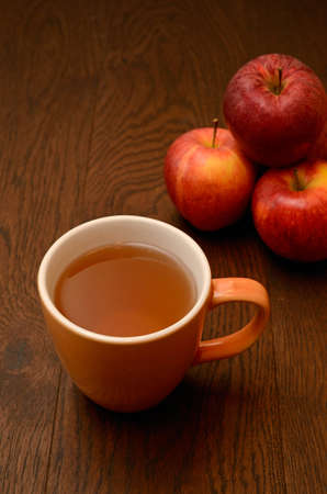Apple tea with fresh apples photo