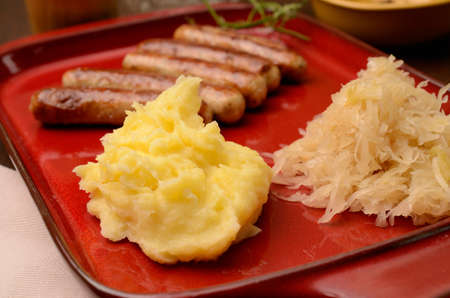 Sauerkraut with sausages and mashed potatoes photo