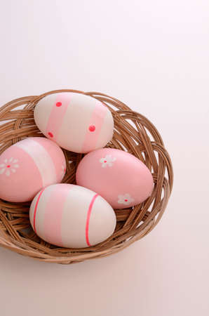 Pink Easter eggs in a bowl photo