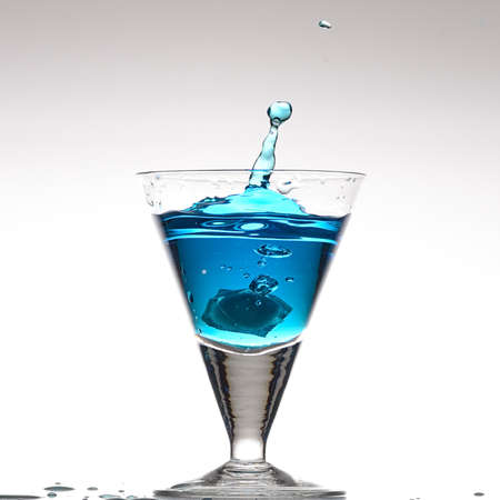 Splashing blue cocktail photo