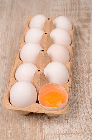 Organic eggs on a wooden table photo
