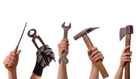 Female hands with old used tools on a white  photo