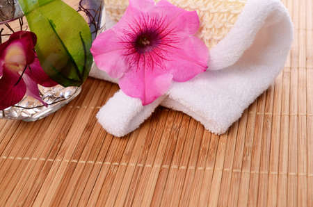 bath additive: Bath additive with towel and pink flower decoration