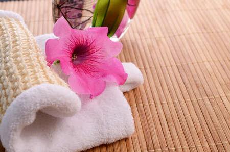 bath additive: Bath additive with a towel and flower decoration