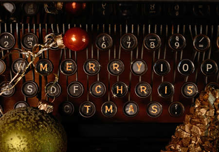 Old typewriter with Merry Christmas decorations photo