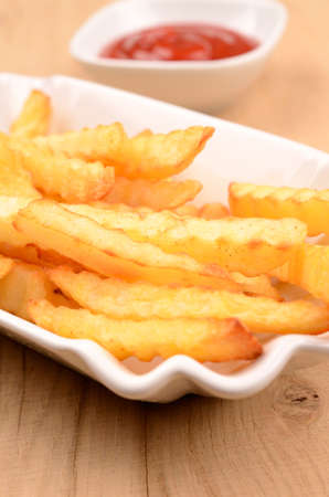 frites: Pommes frites in a white bowl Stock Photo