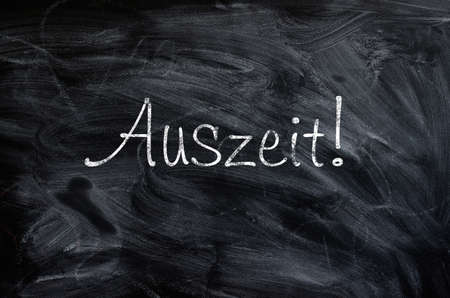 auszeit: Blackboard with the German word Auszeit , Time out concept