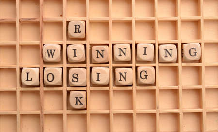 Business concept with wooden dices and the words Risk, winning and losing Reklamní fotografie