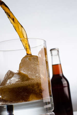 cold: Pouring glass of cold cola