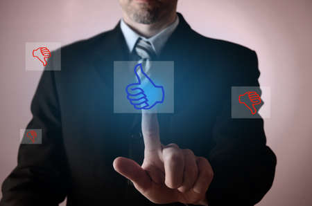 thumb up icon: Business man pointing on a thumb up icon, positive business concept Stock Photo