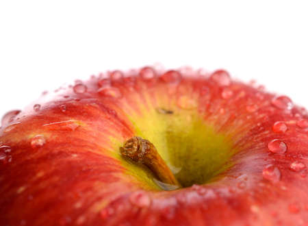 Close up of a fresh apple with drops of water