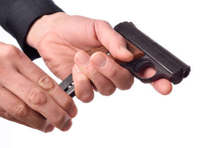 finger on trigger: Hands with a handgun on a white background