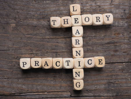 Business concept on an old wooden background with the words learning, theory and practice Reklamní fotografie