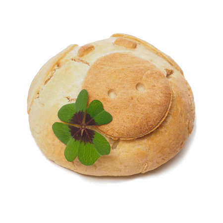 lucky clover: Baked lucky pig with a green clover on a white background, Luck concept image Stock Photo