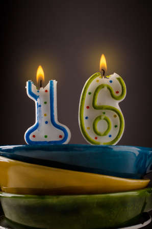 sixteen: Colorful birthday candles with the number of sixteen