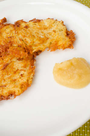 fritters: Delicious potato fritters and applesauce on a plate