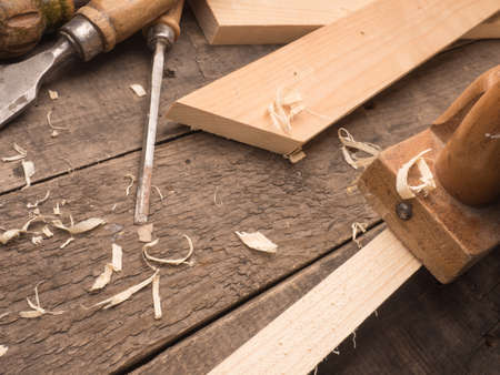 carpenter's bench: Old used carpenter tools on a wooden workbench