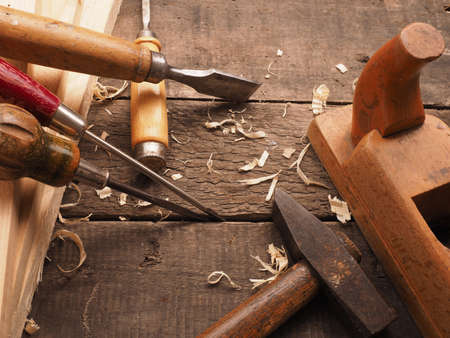 carpenter's bench: Old used carpenter tools on a workbench