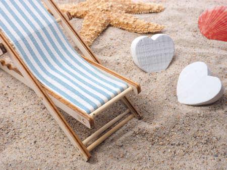 deckchair: Blue deckchair with starfish in the sand on a beach