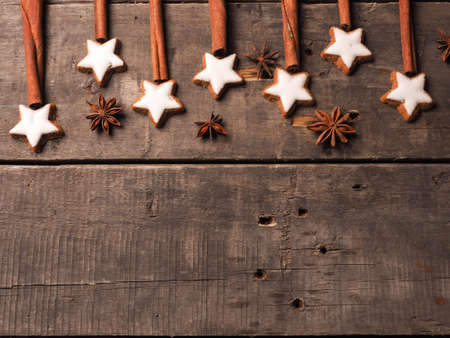 Sweet cinnamon stars with anise on a wooden table