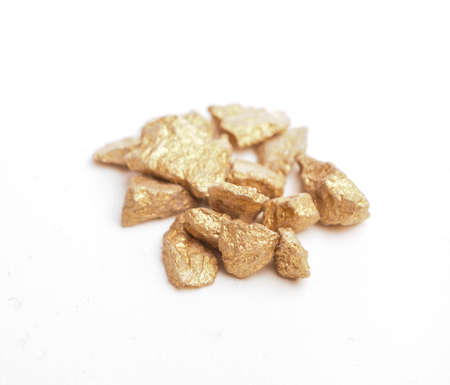 Close up of golden nuggets on a white background Stock Photo