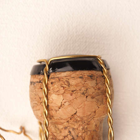 Champagne bottle cork on a white fabric, close up shot